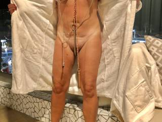 My wife flashing on the hotel balcony and showing her clamped nipples and clit, slut collar and anal hook