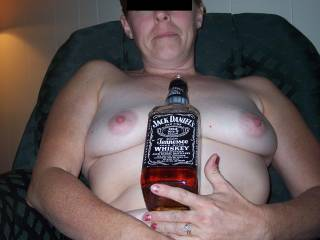 have a shot of Jack and then fill you with this hard cock until you cum all over it, then have you ride me hard! Fuck me !