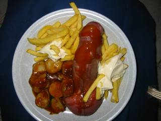"German speciality, called ""Pommes mit Cyrrywurst"""