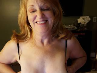 Oh my God. A beautiful mature woman presenting a fantastic set of cum-covered tits. I am in lust right now.