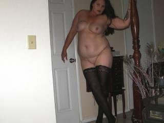 Posing in black nylons and high heels