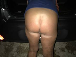 ass outdoors by the car