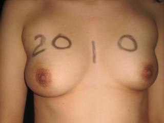 Her beautiful breasts marked for the occasion.