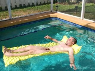 Pic my friend took of me in our friends pool getting some sun.