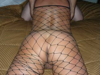 sexy in her body stocking giving her lover a good BJ.  Who\'s next???