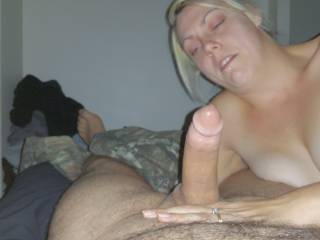 Britt admiring my big cock while she sucks it. Anybody like to help her with it?