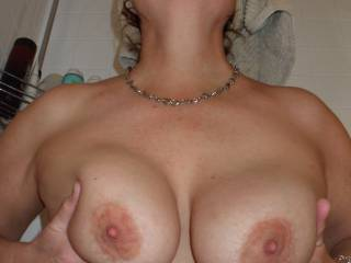 Cupping my big tits for you...do you wanna suck, fuck or sperm blast them?
