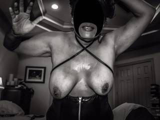 An artistic shot of my tits and mouth covered in cum!