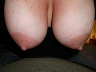 I'd love to suck them while you are riding the hard cock you have given me.