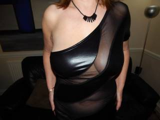 That is a fantastic dress showing off an amazingly sexy breast.  I would love to play with your funbags and make you moan like a whore while getting you off before you drop to your knees and swallow my cock deep down to the balls