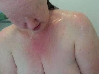 Admiring her own huge milk filled lactating breasts and the amazing cleavage they produce!  Titty fuck anyone?