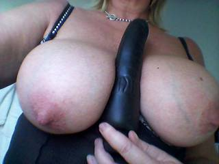 Black dick between my tits. Mmm