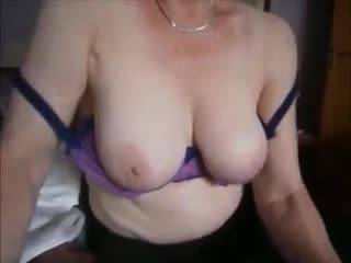 Busty mature Irene playing with her big tasty tits!