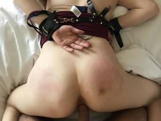 She was hog tied so after working over her ass a little, I undid her ankles so I could fuck  that little pussy leaving her helpless hands behind her back face slammed into the bed with every thrust!