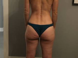 Here she is in some new bikini bottoms.She can\'t wait for the summer to show off her sexy ass at the beach. I think this shows off the perfect amount of ass.Should I buy her something that shows off even more ass?