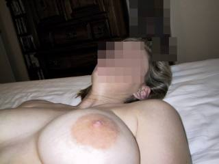 My wife\'s big creamy white tit and nipple just for you!