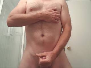 Jerking my cock with a good cumshot and some nipple play.