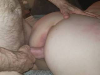 Here he is spreading her out from behind and working her up.  We were already an hour or two in to this session.  By this time he had already made her cum and squirt a few times but this time he wanted to show off her swollen pussy to me before he beat it