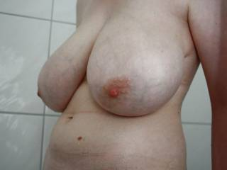 Is your cock long enough to stick out between my tits while I suck the head?