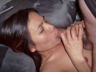 This is an older pic of her sucking 1 of the guy\'s dicks. It is so old that the wife and I can\'t remember who dick it is. She sucks so many dicks she can\'t remember them all. We usually try to organize the pics of her being shared, but this one got lost.