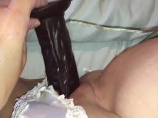 Great choice on keeping the lingerie on.. loving the sounds of that hot wet juicy pussy from that black dildo and yes it would be a pleasure of mine to wanting to help you