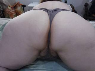 Wife showing off her ass to Hubby.