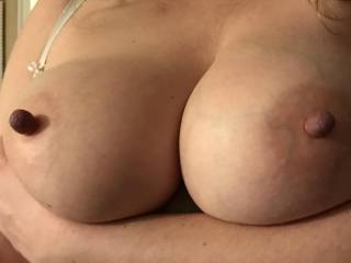 Kiki holding up her big tits with nipples tied tight! Any ladies want to have their nipples tied so you can rub them against Kiki's nipples? Fuck they are fun to suck on like this