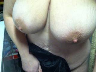 Slut wife's big heavy tits hanging down her chest