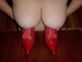 Though red heels are always sexy her tits and nips are unbeatable!