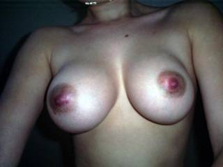 You have beautiful breasts with luscious nipples. Yes, I would squirt my cum all over your sexy tits.