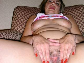 Another photo of my lovely Hotwife spreading her married pussy nice and wide for all to see! I watched in amazement as her Bull ordered her to pose for these photos prior to fucking her mouth and pussy! Don\'t you also love those big saucer nippled tits?