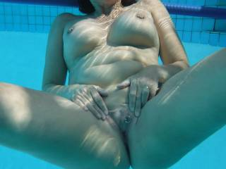 Relaxing in the swimming pool at home. Playing with my pierced pussy.