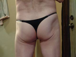 Just showing my ass. Wife says it\'s sexy in thong and I should be an underwear model. Anyone agree?  Comments, please.