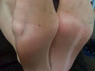 Sexy feet in tan tights