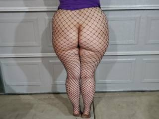 Big ass in fishnet stockings