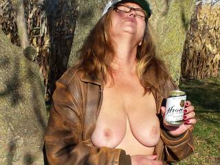 Wow, awesome pic.  Luv the glasses, keeps my cum out of your eyes.  Also, luv the nails, those would look great wrapped around my cock, stroking it up and down until I shoot a load on them beautiful tits, all outdoors of course.