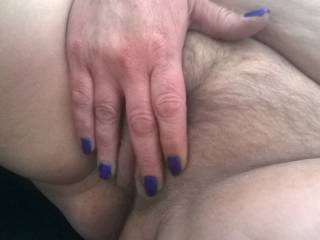 Pretty painted nails rubbing her phat hairy pussy. Mmmmmm lucky fingers