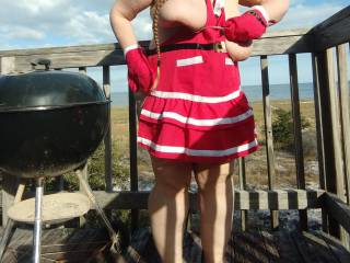 My girl Christmas cooking outdoors beachside. Anyone else like a serving of those amazing breasts?