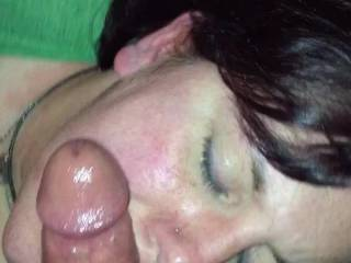 Asked her to come over and watch a movie. Threw my cock on her face and she took it from there. I really think she liked the cum bath!!