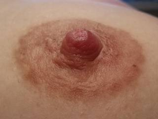 close up of my nipple, they really won\'t sit flat anymore now that I am still breastfeeding.