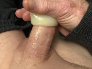 Masturbating with a stroker.