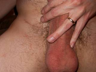Nice cock and balls shot. A helping hand is always appreciated.