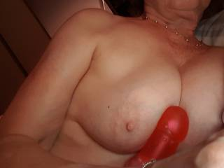 Busty mature Irene rubbing her toy on her big tits