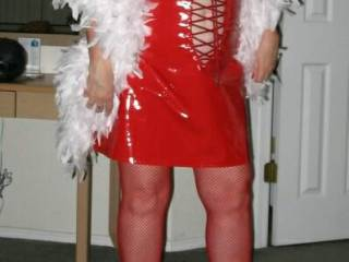 My wife in one of her slut outfits.  We call this the Harlot in Red outfit.  I fantasize about her showing up in a bar wearing this outfit and picking up several men to take back to her hotel room.  There I watch them all use her over and over all night l