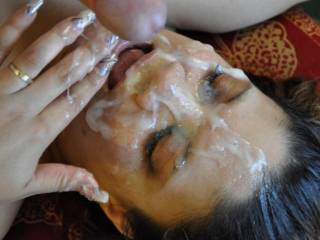 Soo much hot gooey sperm on her face!  I love it!  I want to add my load of warm jizz!