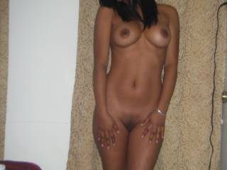 Aint she hot!  The wife showing off at home for me!