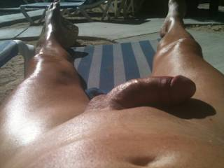 I\'m getting some sun at a local clothing optional resort.  Do you like my smooth cock and balls?  Hope so.