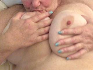 My BBW wife sucking her hard nipples on her big natural tits.