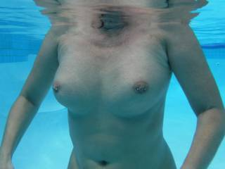 Underwater view of my pierced tits in the swimming pool at home.