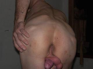 Cool shot of your cock and balls squeezed between your legs.